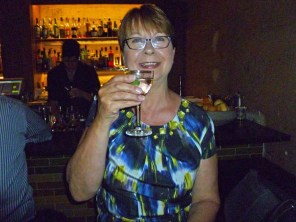 and enjoys a martini